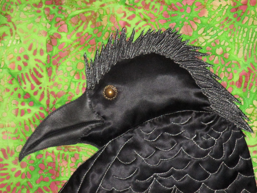 Black satin and silver threads create this elegant mohawked crow.